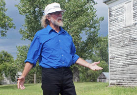 FILE - In this Aug. 26, 2013 file photo, white supremacist Craig Cobb stands in an empty lot he owned in Leith, N.D.