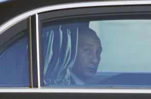 Russia's President Vladimir Putin arrives to attend a summit to discuss the conflict in Ukraine at the Elysee Palace in Paris, France, October 2, 2015.
