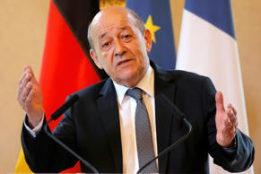 French Defence Minister Jean-Yves Le Drian speaks before a signing ceremony at t...