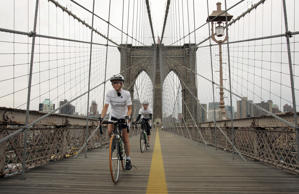 Bicyclists cross the Brooklyn Bridge