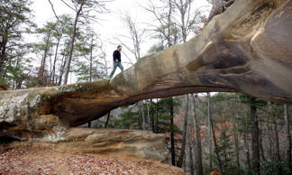 Tim Eling, Red River Gorge manager, U.S. Forest Service, poses for a photo on Princess Arch in the gorge, Nov. 17, 2008, near Stanton, Ky. The Red River Gorge area in eastern Kentucky attracts thousands to its beautiful and unique rock formations each year, but some careless visitors never leave. The 42,000-acre geological area that reaches into parts of Menifee, Powell and Wolfe counties make it a popular destination for day hikers, overnight campers and rock climbers.