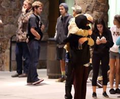Students embrace outside a hospital emergency room in Flagstaff, Ariz., on Frida...