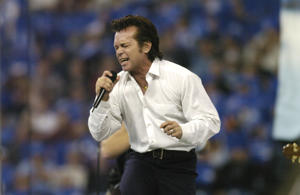 John Mellencamp entertains at halftime at a Thanksgiving Day game, November 25, 2005 in Detroit.