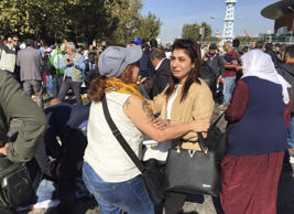 People gather at the site of an explosion close to Ankara's main train station o...