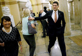 U.S. Representative Paul Ryan, right, says hello to a tourist as he returns to his office after a Republican caucus meeting at the U.S. Capitol in Washington, October 9, 2015.