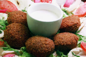 A falafel dish is prepared for a customer in the Just Falafel food outlet at the...