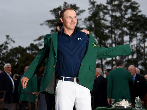 AUGUSTA, GA - APRIL 12: Jordan Spieth of the United States is presented with his Green Jacket after the final round of the 2015 Masters at Augusta National Golf Club on April 12, 2015 in Augusta, Georgia.