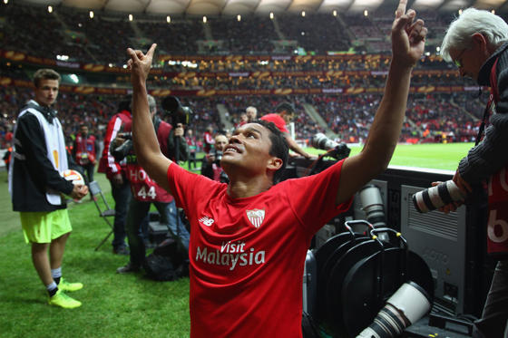 WARSAW, POLAND - MAY 27: Carlos Bacca of Sevilla celebrates scoring his team's third goal during the UEFA Europa League Round Final match between FC Dnipro Dnipropetrovsk and FC Sevilla on May 27, 2015 in Warsaw, Poland