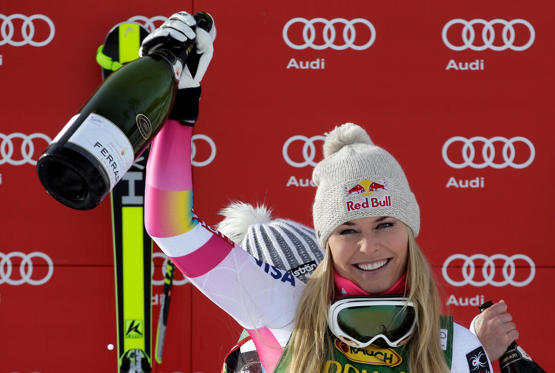 Lindsey Vonn of the U.S. celebrates with champagne on the podium after winning the women's World Cup Super-G skiing race in Cortina D'Ampezzo January 19, 2015. Vonn became the most successful female in Alpine skiing World Cup history when she won a Super-G on Monday, her 63rd victory in the competition.