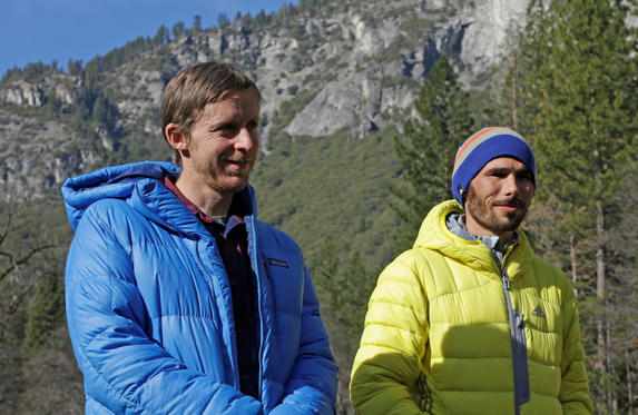Tommy Caldwell, left, and Kevin Jorgeson wait to speak during a news conference Thursday, Jan. 15, 2015, in El Capitan meadow in Yosemite National Park, Calif. The two climbers became the first in the world to use only their hands and feet to scale El Capitan, a sheer granite face in California's Yosemite National Park.