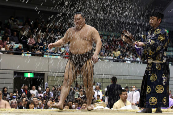 HIMEJI, JAPAN - MARCH 31: Sumo Grand Champion Hakuho Sho throws salt before competing in the Grand Sumo Tournament at the Himeji Chuo Gymnasium on March 31, 2015 in Himeji, Japan. The highest ranking sumo wrestlers participated in this special Grand Sumo Tournament to celebrate the re-opening of Himeji Castle after five years of full-scale restoration work.