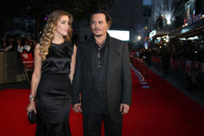 Actor Johnny Depp, right, and partner Amber Heard pose for photographers upon arrival at the Premiere of the film Black Mass, showing as part of the London Film Festival, in central London, Sunday, Oct. 11, 2015. (Photo by Grant Pollard/Invision/AP)