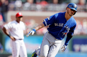 Toronto Blue Jays third baseman Josh Donaldson (20) rounds the bases after scoring a two-run home run against the Texas Rangers.