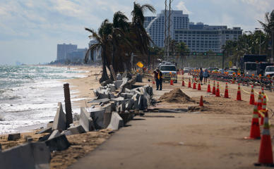 Cones mark off the damage caused by beach erosion along route A-1-A, making parts of it impassable to vehicles on November 27, 2012 in Fort Lauderdale, Florida.
