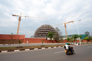 Construction cranes operate at the site of the Kigali Convention Center in Kigali, Rwanda.