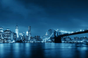 Brooklyn bridge at night in New York City.