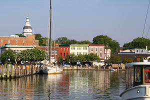 View from a boat in Annapolis Harbor showing the Maryland Statehouse and the Annapolis waterfront.