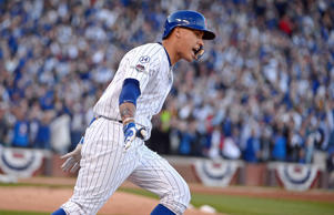 Javier Baez of the Chicago Cubs runs the bases after hitting a three-run home ru...