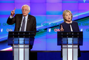 Hillary Rodham Clinton, right, and Sen. Bernie Sanders, of Vermont, speak during the CNN Democratic presidential debate Tuesday, Oct. 13, 2015, in Las Vegas.