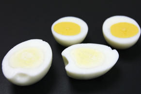 TOKYO - SEPTEMBER 30: A boiled egg with a whiter yolk is seen next to an ordinary boiled egg at the Q.P. Corp Research and Development centre on September 30, 2004 in Tokyo. The whiter yolked egg was developed by the Japanese food company Q.P. Coporation by changing the composition of the feed given to chickens to reduce the colouring matter of the yolks. Q.P. Corp are planning to sell the eggs to confectionary companies as it is believed the whiter yolk will make it possible to produce more subtle colourings than is currently possible. The eggs are expected to cost 30-40 percent more than ordinary eggs.