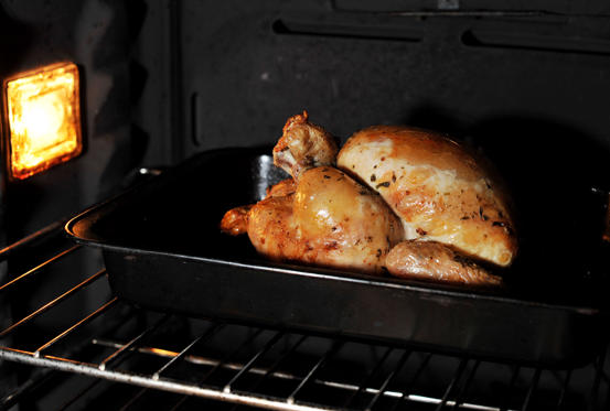 A chicken being roasted in a household oven, as poor food hygiene, preparation and under cooking can result in salmonella infection
