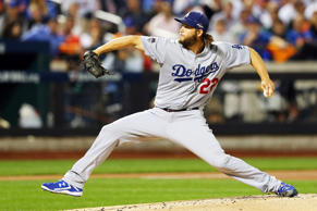 Clayton Kershaw #22 of the Los Angeles Dodgers throws a pitch in the first innin...