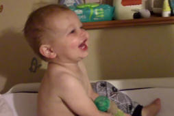 Baby can't stop laughing at favorite movie scene