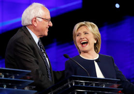 Sen. Bernie Sanders, of Vermont,, left, and Hillary Rodham Clinton laugh during ...