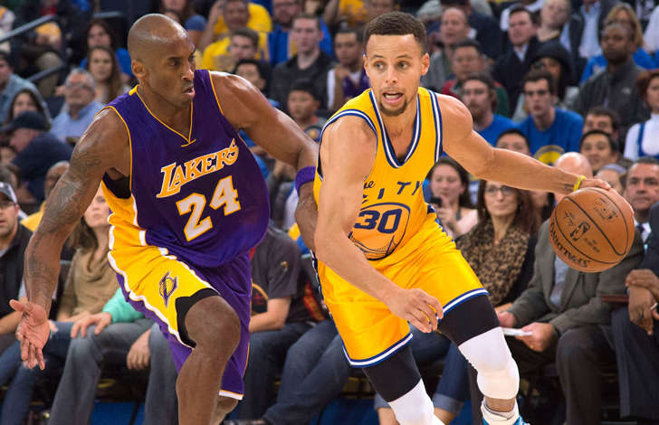 Golden State Warriors guard Stephen Curry,right, dribbles the  ball against Los Angeles Lakers forward Kobe Bryant during a game on Nov. 24, 2015, in Oakland, Calif.