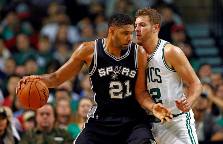 San Antonio Spurs forward Tim Duncan, left, dribbles as Boston Celtics forward David Lee defends during the first half at TD Garden on Nov. 1 in Boston.