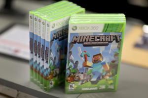 XBox 360 version of Minecraft game is seen at a GameStop store on Septemeber 15, 2014 in Miami, Florida.