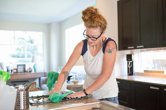 So you cooked up a storm, and your kitchen has seen better days. Clean up your counters and stovetop with three things: baking soda, vinegar, and a little elbow grease. Start by applying white vinegar to the greasy surface. Let it sit for 10 minutes, then scrub it with a damp sponge or cloth that has baking soda sprinkled on it.
