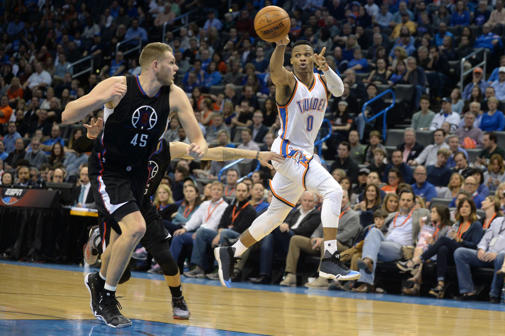 Oklahoma City Thunder guard Russell Westbrook (0) passes the ball in front of Los Angeles Clippers center Cole Aldrich (45) during the fourth quarter at Chesapeake Energy Arena.