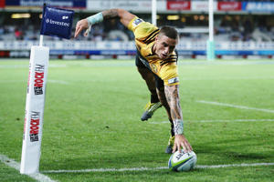 TJ Perenara of the Hurricanes dives over to score a try during the round three Super Rugby match between the Blues and the Hurricanes at Eden Park on March 11, 2016 in Auckland, New Zealand