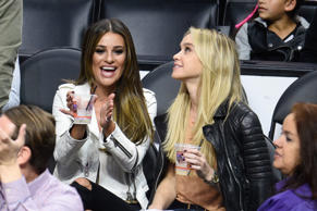 Lea Michele (L) and Becca Tobin attend a basketball game between the New York Kn...