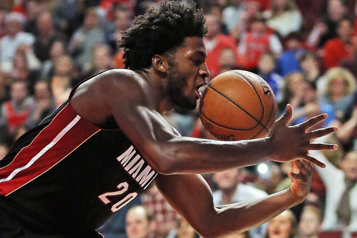 Justise Winslow (20) of the Miami Heat grabs a rebound against the Chicago Bulls at the United Center on March 11, in Chicago, Illinois. The Heat defeated the Bulls 118-96.