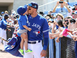 Troy Tulowitzki of the Toronto Blue Jays kisses his son, Taz, before a spring training game against the Baltimore Orioles on March 4, 2016, in Dunedin, Fla.