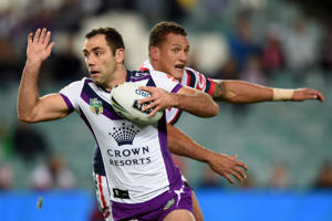 Cameron Smith makes a break through the Roosters' defence.