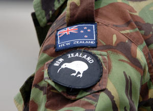 New Zealand Army monogrammed badge and flag on sleeve of deployed defence force