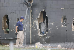 ORLANDO, FL - JUNE 12:  FBI agents investigate near the damaged rear wall of the Pulse Nightclub where Omar Mateen allegedly killed at least 50 people on June 12, 2016 in Orlando, Florida. The mass shooting killed at least 50 people and injuring 53 other