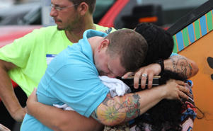 "Ben Johansen grieves at The Center, a LGBT community center in Orlando following the shooting at the Pulse nightclub, on June 12, 2016. ""Why, why, why,"" he said."
