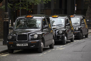 LONDON, ENGLAND - JUNE 02: Taxis wait on a rank in Westminster on June 2, 2014 in London, England. The controversial mobile application 'Uber', which allows users to hail private-hire cars from any location, is opposed by established taxi drivers and currently serves more than 100 cities in 37 countries. London's black cabs are seeking a High Court ruling on the claim that the Uber software is breaking the law by using an app as a taxi meter to determine rates. (Photo by Oli Scarff/Getty Images)
