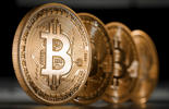 A close-up view of an illustration model of a Bitcoin is seen on Dec. 6, 2013 in Berlin, Germany.
