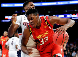 Maryland's Diamond Stone (33) drives past Connecticut's Kentan Facey (12) during the second half of an NCAA college basketball game, Tuesday, Dec. 8, 2015, in New York. Maryland won 76-66. (AP Photo/Frank Franklin II)