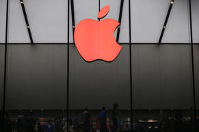 A red Apple logo is seen on the Apple store on December 1, 2015 in Hangzhou, Zhejiang Province of China.