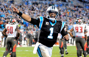 Carolina Panthers quarterback Cam Newton celebrates a touchdown against the Tamp...