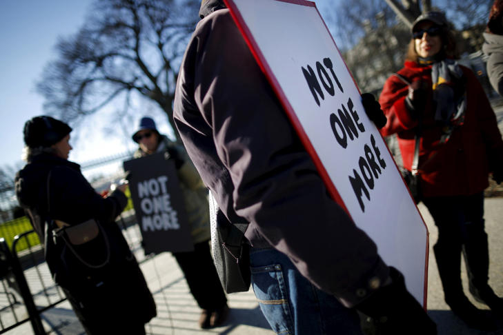 Gun control activists rally in front of the White House in Washington, January 4, 2016. President Barack Obama is expected to announce new gun control curbs this week, but he will have to decide whether to take bold action that would likely spark a major legal challenge from opponents or a more cautious route that may be less effective, legal experts said.