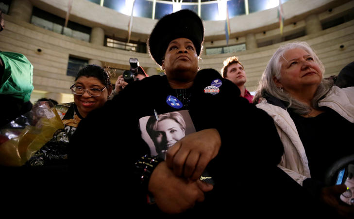 Lennette Williams, of Grosse Pointe Farms, Mich., listens as Democratic presidential candidate, Hillary Clinton speaks during a rally at the Charles H. Wright Museum of African American History, Monday, March 7, 2016, in Detroit, Mich.