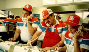 Domino's employees taking phone orders in the 1980s.