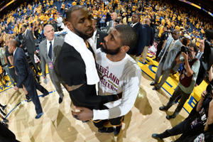 LeBron James #23 and Kyrie Irving #2 of the Cleveland Cavaliers celebrate after defeating the Golden State Warriors in Game Five of the 2016 NBA Finals on June 13, 2016 at Oracle Arena in Oakland, California.